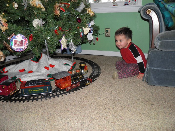 Cesar seeing the train going around the tree for the first time