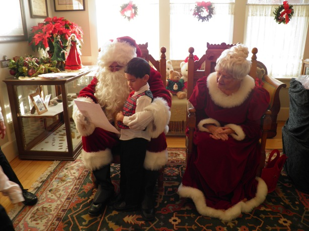 Bency going over his wish list with Santa