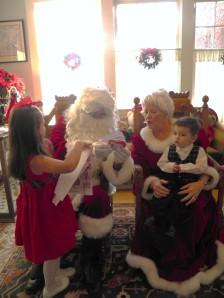 Iris handing her present to Santa