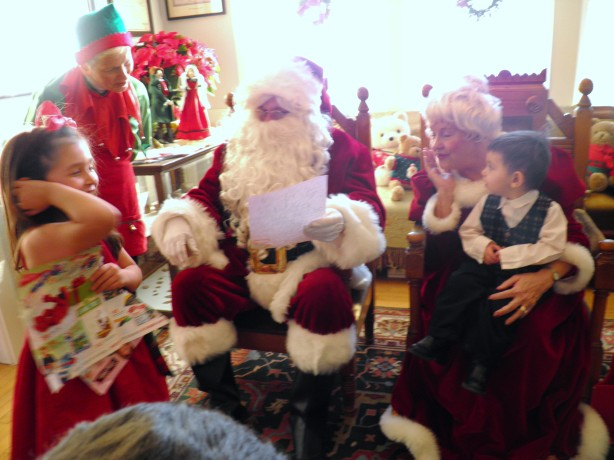 Everyone laughing when Iris shows Santa her letter!
