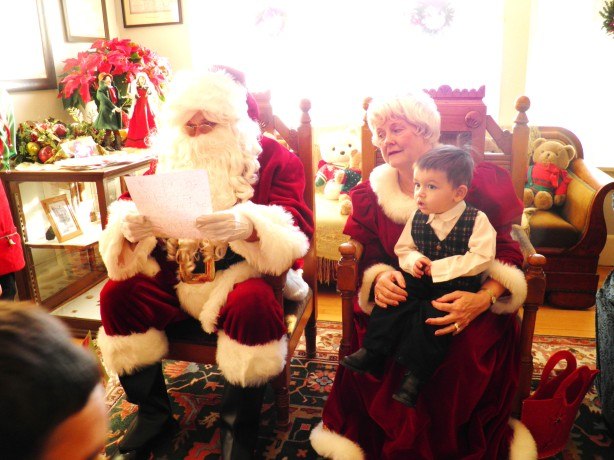 Cesar sitting on Mrs. Claus's lap