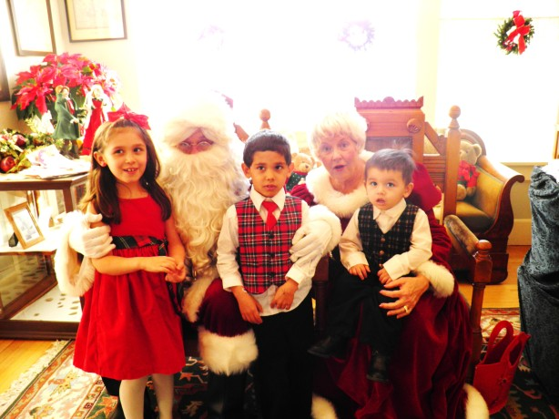 All of the kids posing with Santa and Mrs. Claus