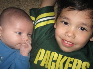 Even as a baby you are envious of your older brother's Packer clothes!