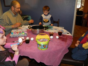 All of the kids coloring eggs