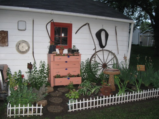 A garden in our yard that my husband made. I added the dresser that I found on the side of the street and painted.