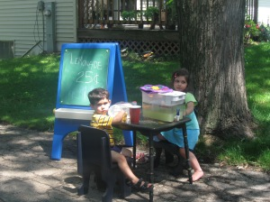 My son and daughter having a lemonade stand at one of my rummage sales.