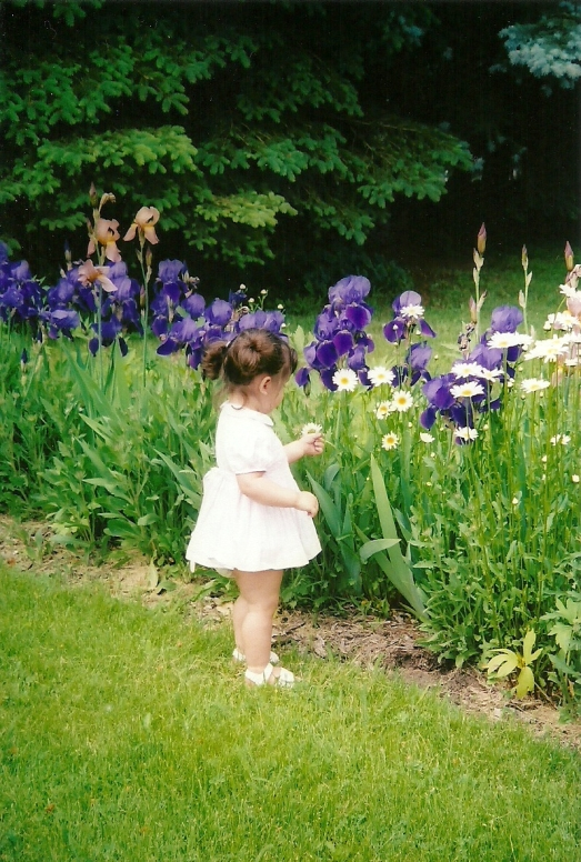 My daughter Iris standing in front of my Mom's Irises when she was 2 years old.