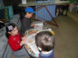 Iris pretending to be the teacher to the boys a few weeks ago