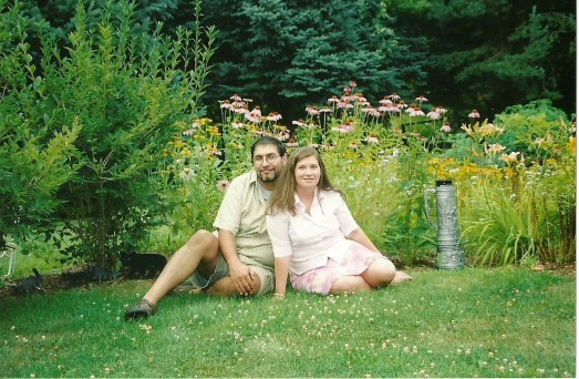 My husband and I by one of my Mom's gardens when we were dating.