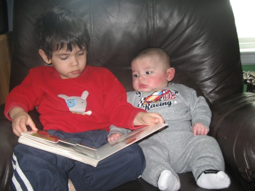One of those sweet moments of Bency reading to Cesar when he was a baby