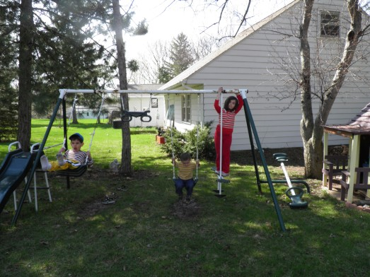 It's finally getting nice so we can play outside...look at all of the mud. Also notice Bency is only wearing socks!