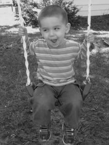 Cesar enjoying swinging