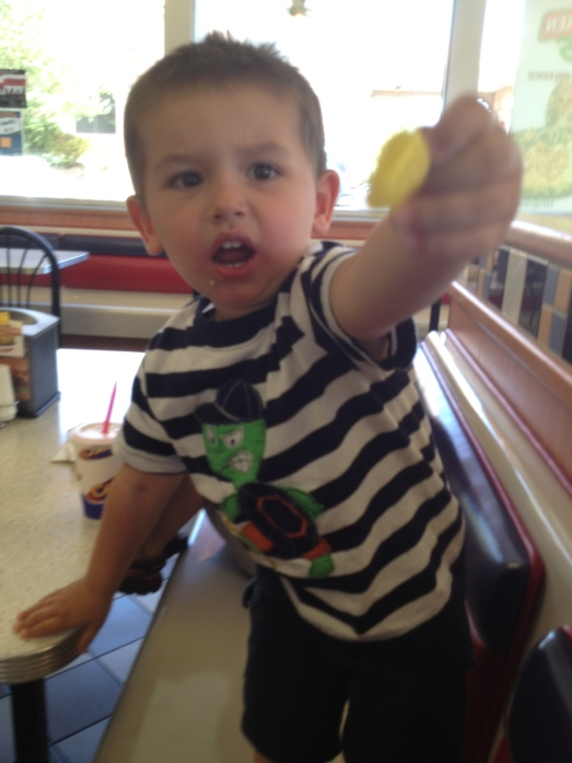 This is my youngest son Cesar giving trying to give his hot pepper back!