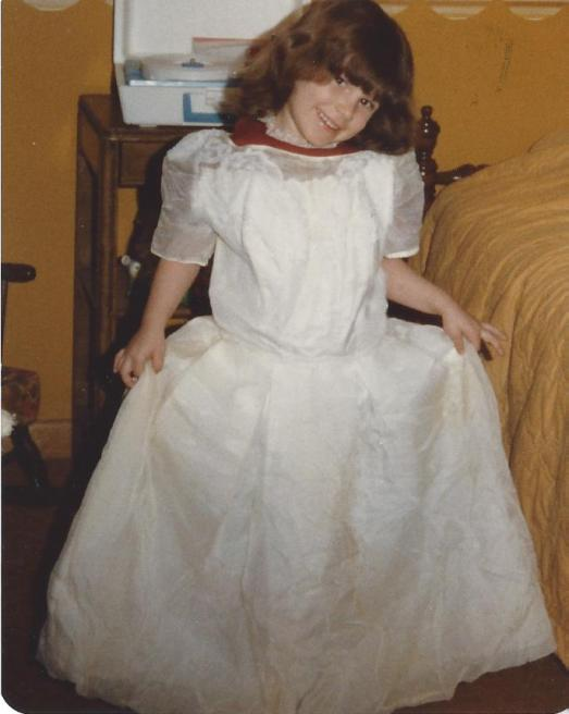 Me at the age of 5 all dressed up in my Mom's wedding dress trying to figure out who I was going to marry!