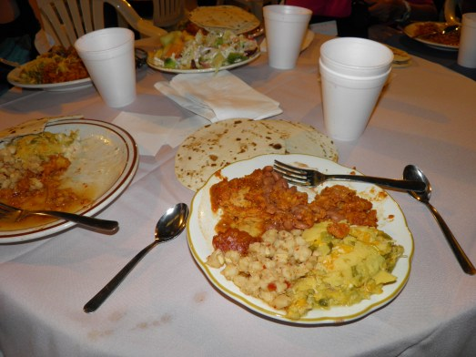 This was one of our meals at the family reunion we went to. Red chile enchilada on the left and green chile enchilada on the right. Beans and pasole (spicy corn stew) in the middle.