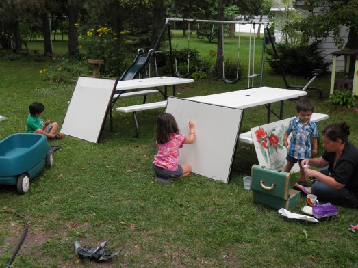 My kids painting huge canvases outside